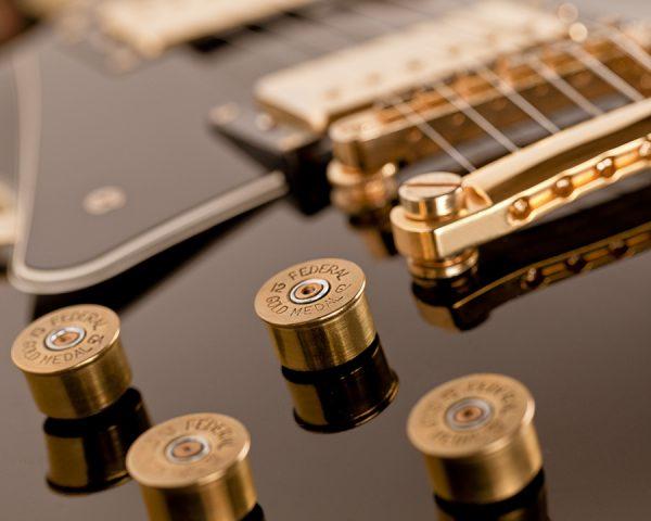 12 Gauge Tone and Volume Guitar Knobs on Black LesPaul