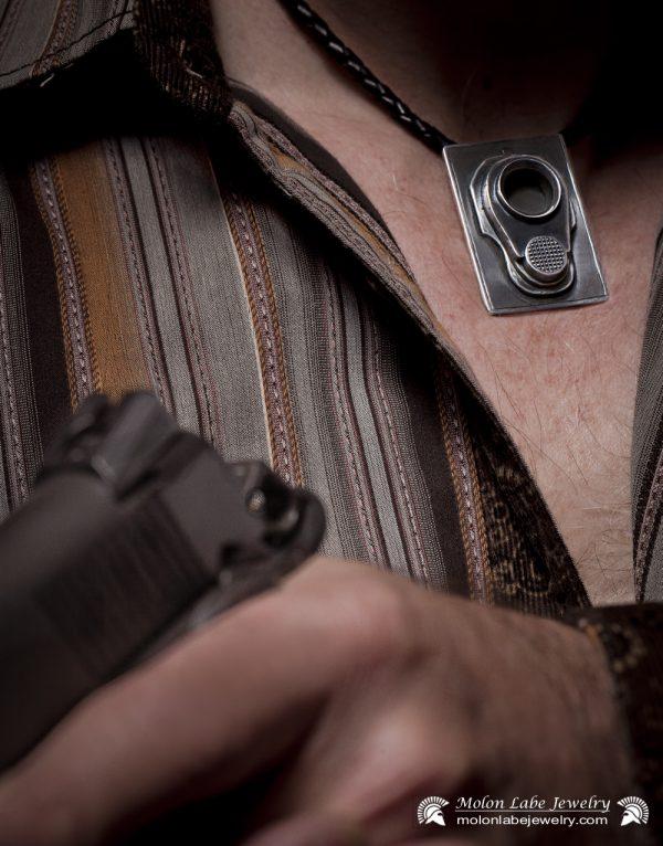 Gun Jewelry -Male model with Colt M1911 45 Muzzle & 2nd Amendment pendant - close up