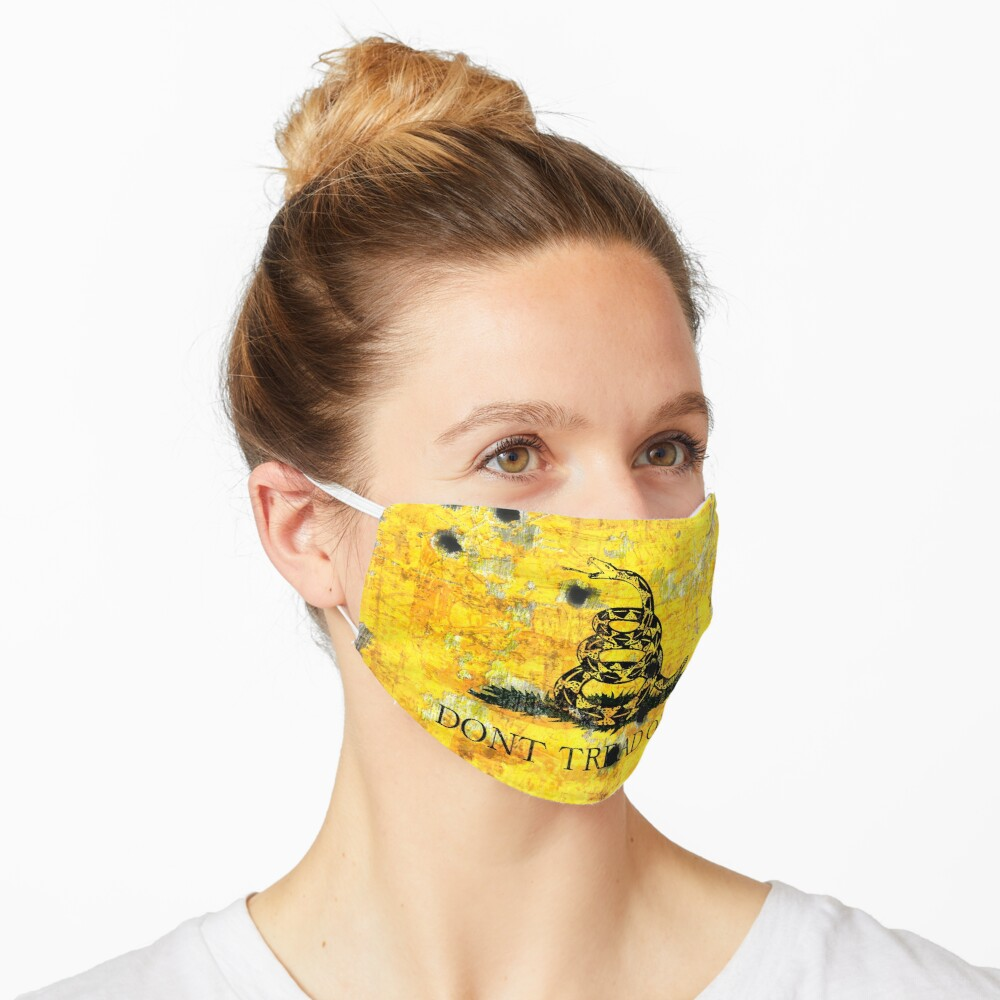 Gadsden Flag on Distressed Metal With Bullet Holes on Face Mask