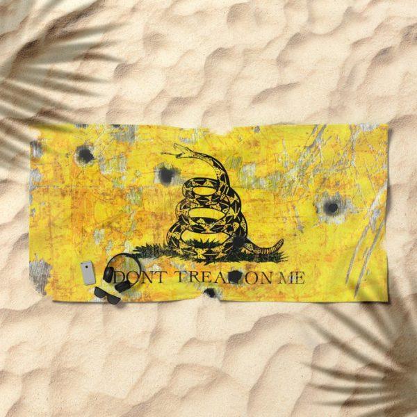 Beach Bathroom Towel Gadsden Flag with Bullet Holes - Don't Tread on Me on the beach