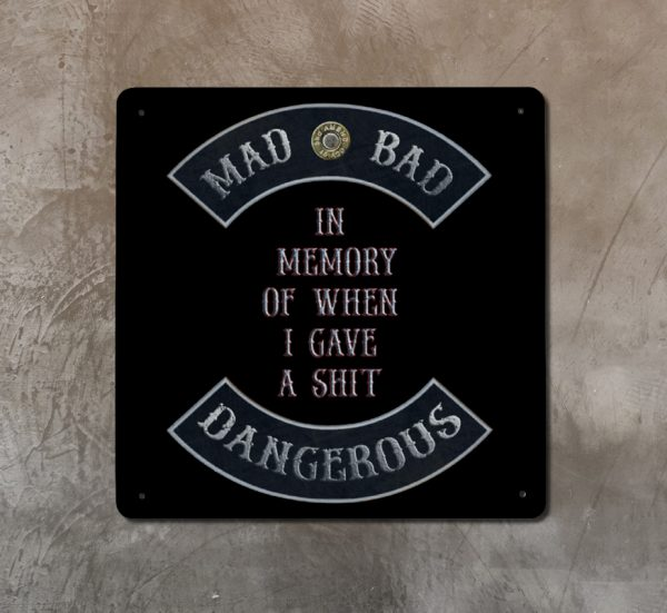 "Mad Bad Dangerous in Rockers with ""In Memory of When I Gave a Shit"" Quote Print on Metal on concrete wall"