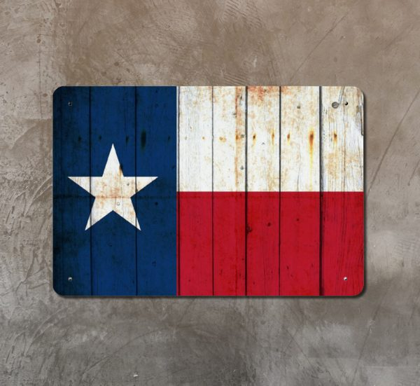 Distressed Texas Flag on old barn wood Print on Metal hung on concrete wall