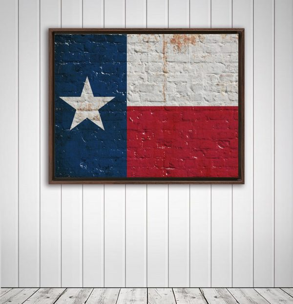 This beautiful print depicts a distressed Texas Flag on brick wall. It is displayed on wood wall